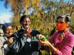 ACT LOCAL: Nikki Brighton (right), locavore extraordinaire, shares her wealth of weedy knowledge with Thenjiwe Ngcobo and Antonia Mkhabela.